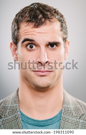 Handsome Caucasian man with a curious expression - stock photo