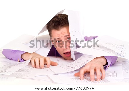 Handsome Caucasian problems Businessman very emotional in the papers on a light background - stock photo