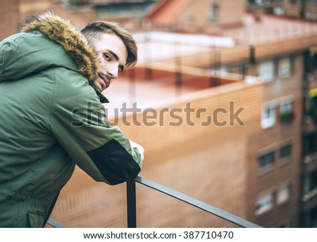 Handsome caucasian young man in casual clothes in urban environment - stock photo