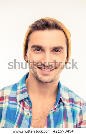 Handsome cheerful cheeky man with hat - stock photo
