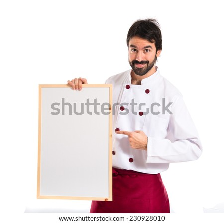 Handsome chef holding empty placard - stock photo