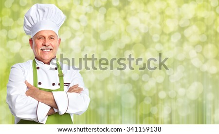 Handsome Chef man over abstract Christmas background. - stock photo
