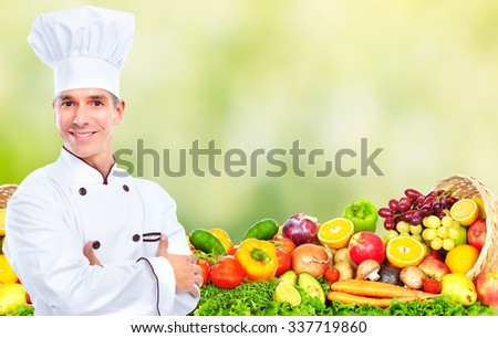 Handsome Chef man over abstract green background. - stock photo