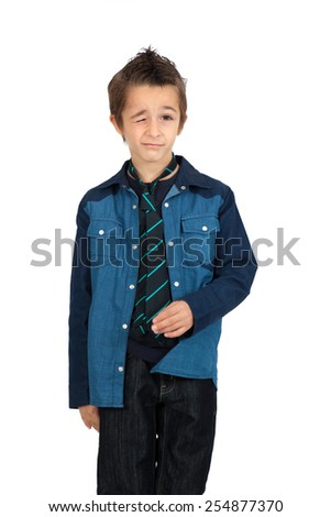 Handsome child doing different expressions in different sets of clothes: blinking - stock photo