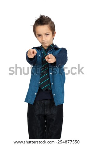 Handsome child doing different expressions in different sets of clothes: gun sign - stock photo