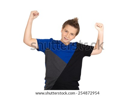 Handsome child doing different expressions in different sets of clothes: zrms raised - stock photo