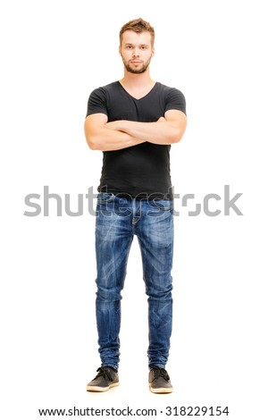 Handsome confidence. Studio full length portrait of young man in casual wear with hands crossed. Isolated on white. - stock photo