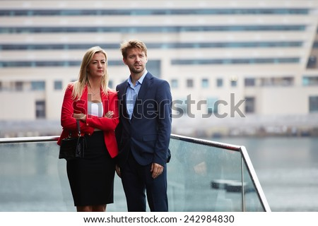 Handsome confident business man looking for realized him project outdoors standing with executive partner, couple of business colleagues at meeting talking about some projects - stock photo