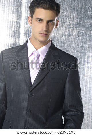 Handsome confident businessman on a gray background
