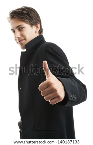 Handsome confident young man giving a thumbs up gesture of success and approval, sideways upper body portrait isolated on white