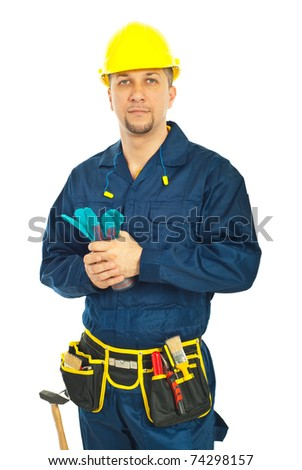 Handsome constructor worker holding gloves isolated on white background - stock photo