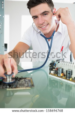 Handsome content computer engineer holding stethoscope in bright office