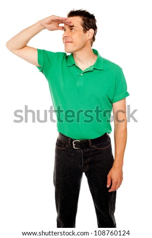 Handsome cool guy looking far away, covering distance with eyesight. - stock photo