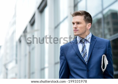 Handsome corporate male looking away - stock photo