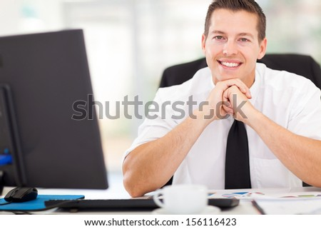 handsome corporate worker looking at the camera
