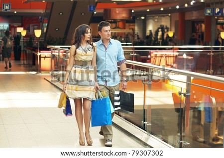 Handsome couple at the shop center - stock photo