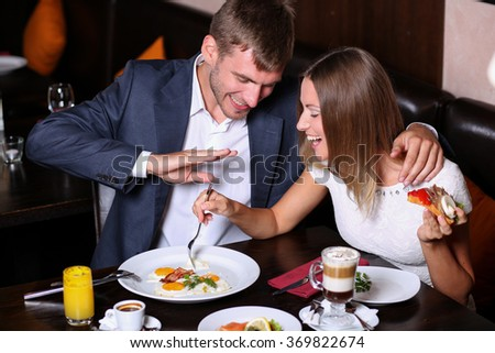 Handsome couple having lunch - stock photo