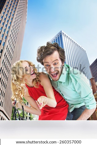 Handsome couple on a shopping trip - stock photo