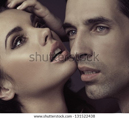 Handsome couple posing - stock photo