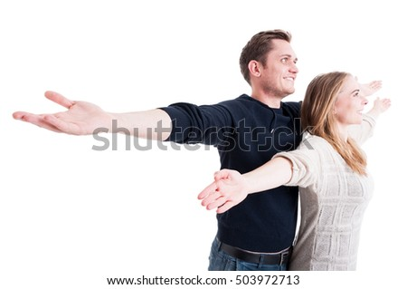 Handsome couple posing like being on Titanic isolated on white background with copy text space