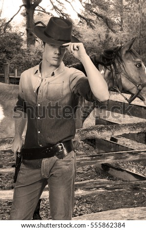 Handsome cowboy man with six shooter guns