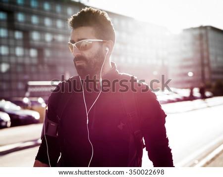 Handsome cyclist portrait wearing sunglasses - stock photo