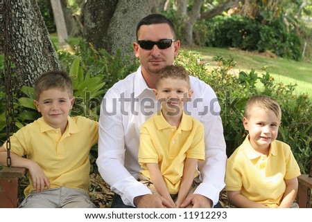 Handsome dad with happy boys - stock photo