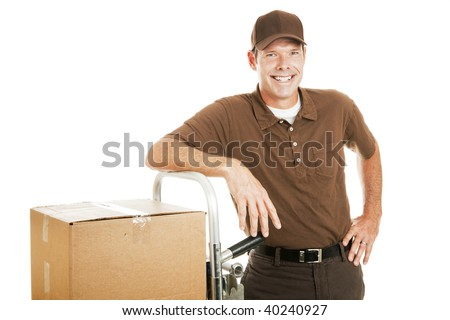 Handsome delivery man leaning on his dolly filled with boxes.  Isolated on white. - stock photo