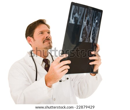 Handsome doctor examining a patient's MRI results.  Isolated on white. - stock photo