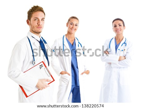 Handsome doctor in front of his medical team - stock photo