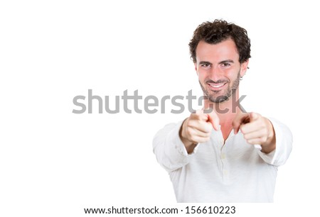 Handsome excited happy young man smiling pointing fingers at you and to the camera, isolated over white background with copy space.