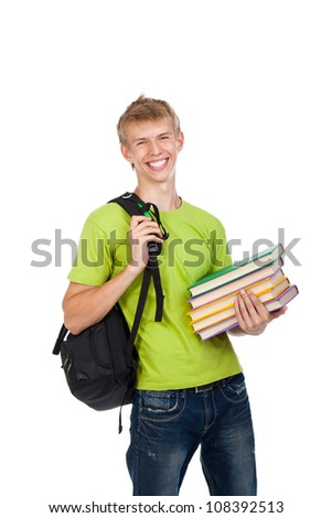 handsome excited man happy smile looking at camera holding stack pile of books, young guy wear green t shirt and school bag, isolated over white background concept of study, knowledge, learn for exam