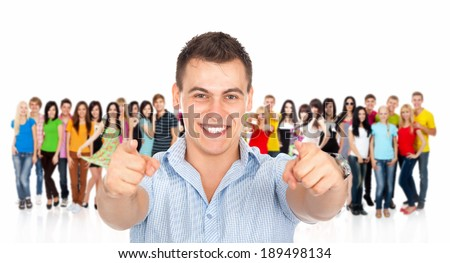 handsome excited man happy smile point finger towards at you to the camera gesture, young guy over big group of casual people diverse student background - stock photo