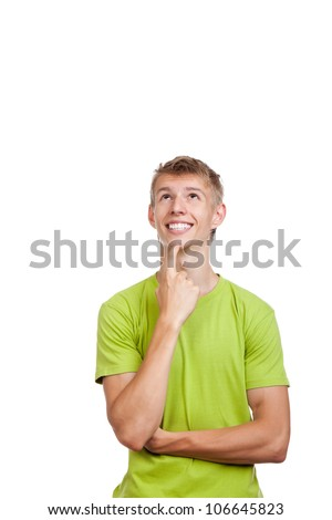 handsome excited man happy smile think looking up to empty copy space,young guy wear green t shirt, white teeth, isolated over white background