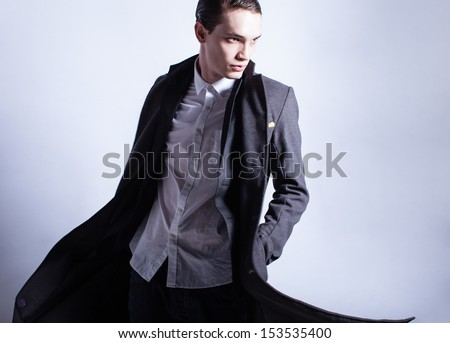 Handsome fashion male model. Fashion studio shoot. - stock photo