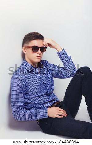 handsome fashion man wearing sunglasses thinking  - stock photo