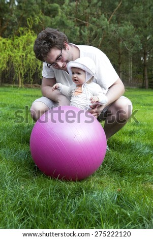 handsome father and his daughter outdoor. Fathers day  - stock photo