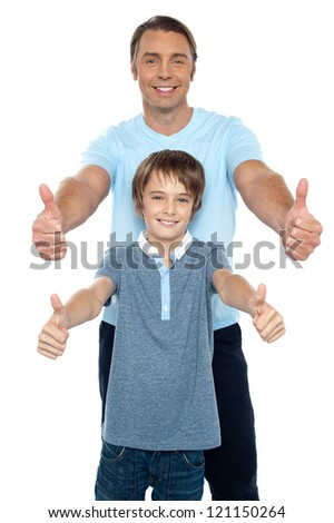 Handsome father and son showing thumbs up gesture to the camera. Capture the moment. - stock photo