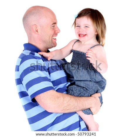 Handsome father laughing with beautiful daughter - stock photo