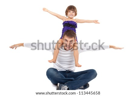 Handsome father with his little daughter on his shoulders happily laughing in the studio. Isolate on white. - stock photo