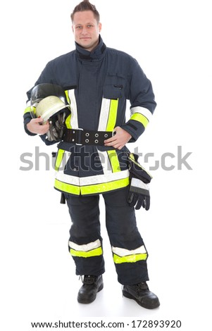 Handsome fireman in his high visibility uniform with his gear including his helmet, gloves and fire axe posing on white