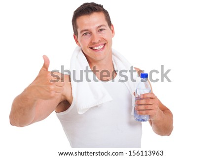 handsome fitness man holding water bottle and giving thumb up isolated on white background