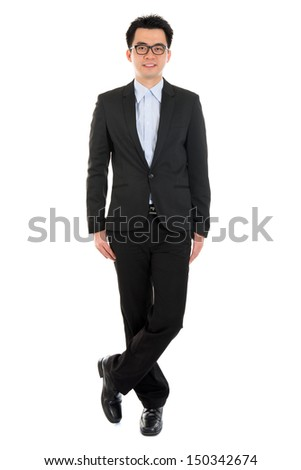 Handsome full body Asian business man in formal full suit standing isolated on white background - stock photo