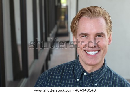 Handsome gay blonde man with a perfect smile - stock photo