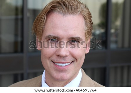 Handsome gay middle-aged blonde man - stock photo