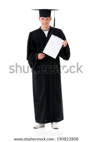 Handsome graduate guy student in mantle showing blank placard board, isolated on white background - stock photo