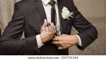 Handsome groom at wedding tuxedo smiling and waiting for bride.  - stock photo