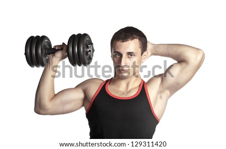 handsome guy in black-and-red undershirt holding dumbbell (low saturation toning) - stock photo