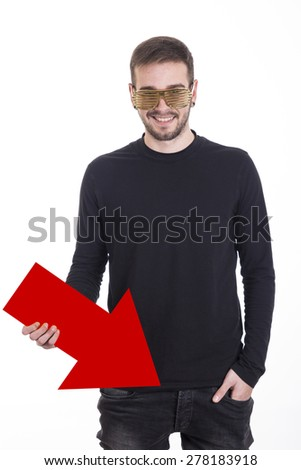 Handsome guy pointing with arrow her trousers - stock photo