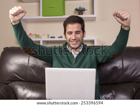 Handsome guy relaxed and using technology on sofa - stock photo